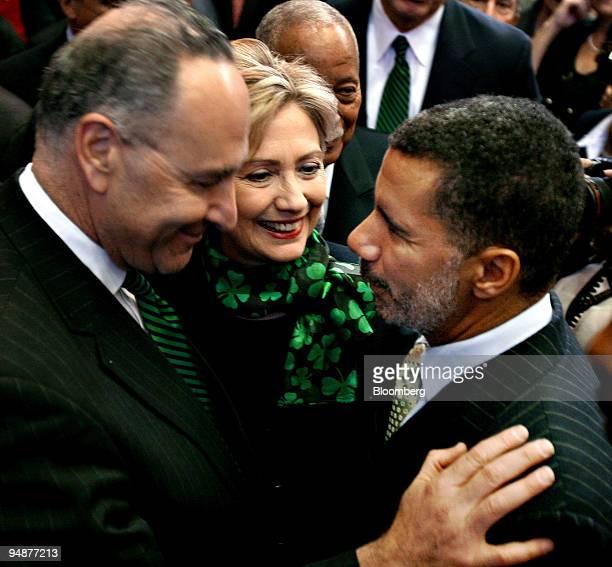 Senator and US presidential candiate Hillary Clinton center smiles as Senator Charles Chuck Schumer left congratulates David Paterson New York's new...