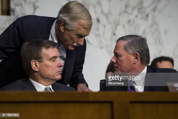 Senator Angus King an Independent from Maine center speaks with Senator Mark Warner a Democrat from Virginia and ranking member of the Senate...