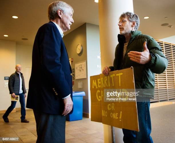 Senator Angus King talks with David Simpson of Peaks Islandbefore a town hall meeting on the subject of Judge Neil Gorsuch's conformation to the...