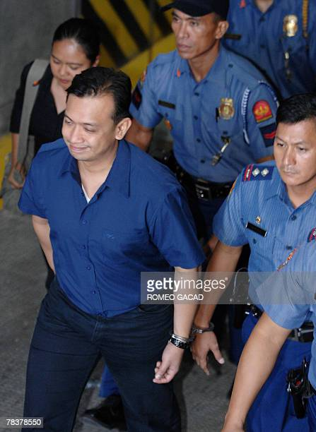 Senator Antonio Trillanes leaves the court handcuffed to a police after a court hearing in Manila 11 December 2007 on the failed 2003 mutiny The...