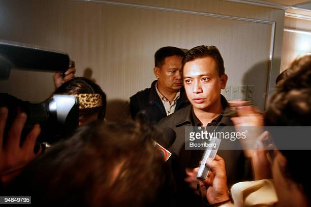 Senator Antonio Trillanes second from the right speaks to members of the media inside the Peninsula Hotel in the business district of Makati...