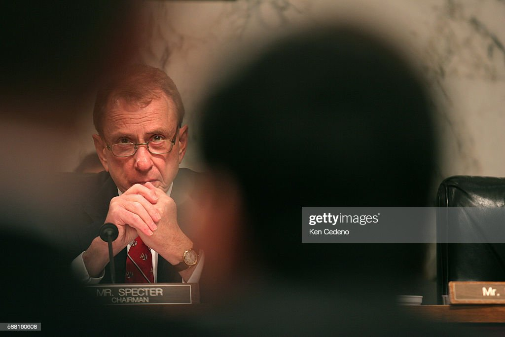 US Senator Arlen Specter listens as U.S. Attorney General Alberto Gonzales testifies before the Senate Judiciary Committee, during a hearing on the Bush administration's domestic spying program on Capitol Hill in Washington, DC February 6, 2006.