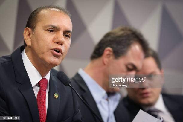 Senator Ataides Oliveira left speaks during a congressional inquiry hearing with Joesley Batista former president and chief executive officer of JF...