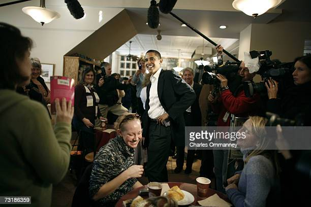 Senator Barack Obama greets supporters during a surprise visit to a coffee shop in Portsmouth, N.H., Sunday, Dec. 10, 2006. Obama drew large crowds...