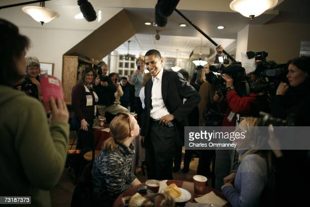 Senator Barack Obama greets supporters during a surprise visit to a coffee shop in Portsmouth NH Sunday Dec 10 2006 Obama drew large crowds and huge...