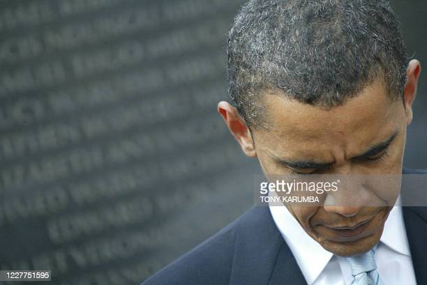 Senator Barack Obama observes a moment of silence in front of a plaque bearing the names of the 1997 terrorist bomb victims August 2006 in Nairobi...
