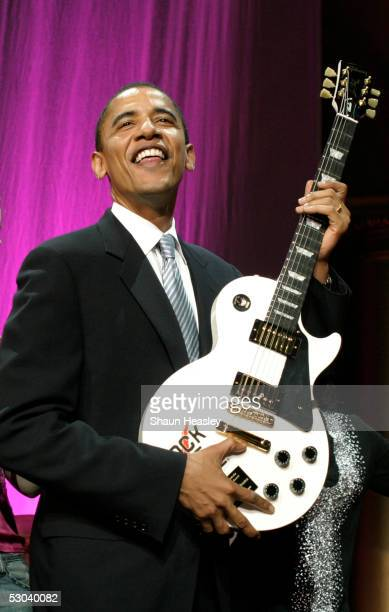S Senator Barack Obama poses with a Gibson guitar after receiving an award at the 12th Annual Rock the Vote Awards held at the National Building...