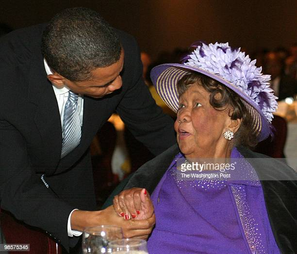 Senator Barack Obama talks with Dorothy Height as he works his way around the main table during the Joint Center for Political and Economic Studies...