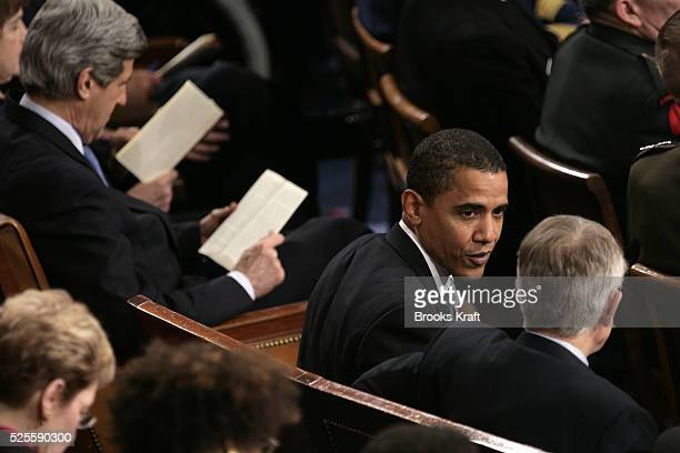 Senator Barack Obama talks with Senator Harry Reid during President Bush's State of the Union address to a joint session of Congress at the US...