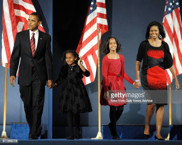 Senator Barack Obama with his daughters Sasha and Malia and wife Michelle on election night in Chicago