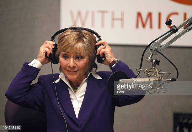 S Senator Barbara Boxer removes her headphones after a radio debate with US Senatorial Republican opponent Carly Fiorina from inside NPR Studios on...