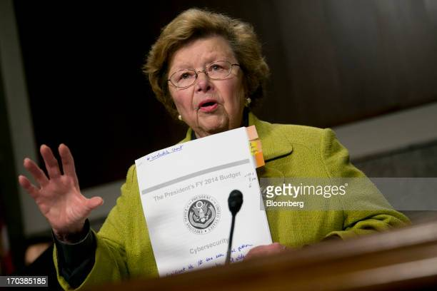 Senator Barbara Mikulski a Democrat from Maryland and chairwoman of the Senate Appropriations Committee holds up a copy of President Obama's 2014...