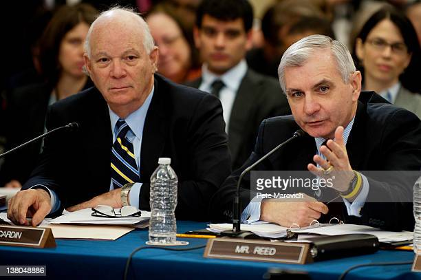 Senator Ben Cardin looks on a US Sen Jack Reed makes his point during a committee meeting to discuss the Temporary Payroll Tax Cut Continuation Act...