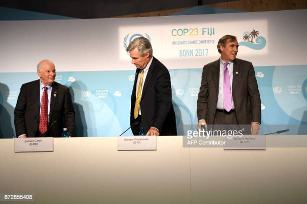 US Senator Ben Cardin Sheldon Whitehouse and Jeff Merkley of Oregon leave a press conference on November 11 2017 during the COP23 United Nations...
