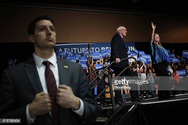 Senator Bernie Sanders an independent from Vermont and 2016 Democratic presidential candidate center arrives with wife Jane Sanders right to speak...