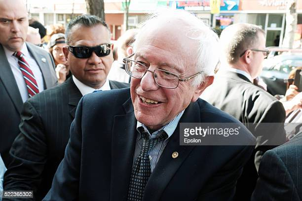 Senator Bernie Sanders an independent from Vermont and 2016 Democratic presidential candidate greets pedestrians on April 18 2016 in the Queens...