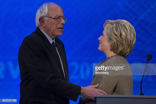 Senator Bernie Sanders an independent from Vermont and 2016 Democratic presidential candidate left speaks with Hillary Clinton former Secretary of...