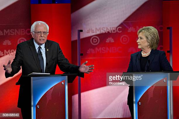 Senator Bernie Sanders an independent from Vermont and 2016 Democratic presidential candidate left speaks as Hillary Clinton former Secretary of...