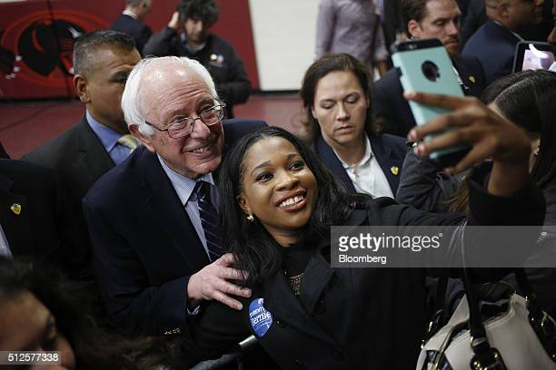Senator Bernie Sanders, an independent from Vermont and 2016 Democratic presidential candidate, poses for a selfie photograph with attendees after...