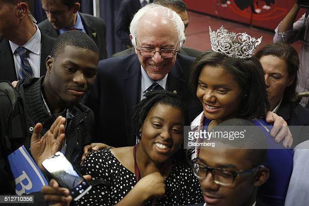 Senator Bernie Sanders an independent from Vermont and 2016 Democratic presidential candidate poses for a photo with supporters after speaking at a...