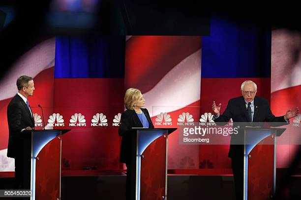 Senator Bernie Sanders an independent from Vermont and 2016 Democratic presidential candidate right speaks as Hillary Clinton former Secretary of...