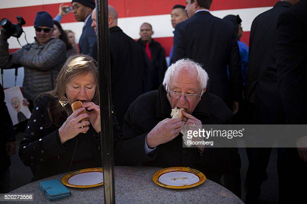 Senator Bernie Sanders an independent from Vermont and 2016 Democratic presidential candidate right and his wife Jane Sanders left eat a hot dog from...