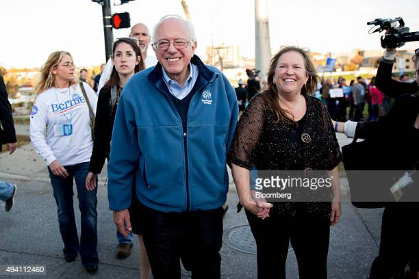 Senator Bernie Sanders an independent from Vermont and 2016 Democratic presidential candidate walks with his wife Jane Sanders ahead of the...