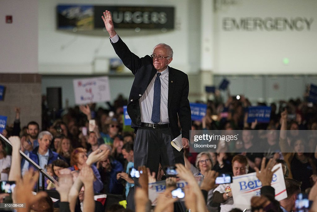 Senator Bernie Sanders, an independent from Vermont and 2016 Democratic presidential candidate, waves as he leave the stage after speaking at a campaign event at the Colorado Convention Center in Denver, Colorado, U.S., on Saturday, Feb. 13, 2016. In the first Democratic debate on Thursday since her crushing defeat in New Hampshire, Hillary Clinton tried a new approach to win back wavering supporters, capturing Bernie Sanders anger without looking angry. Photographer: Matthew Staver/Bloomberg via Getty Images