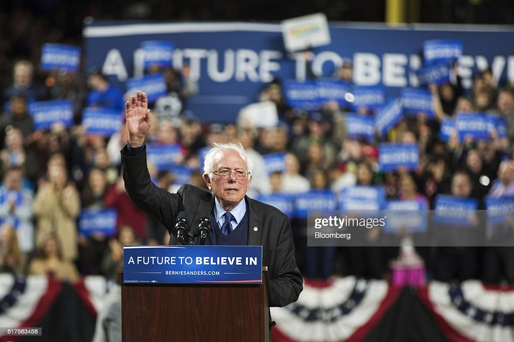 Senator Bernie Sanders, an independent from Vermont and 2016 Democratic presidential candidate, waves during a campaign event in Seattle, Washington, U.S., on Friday, March 25, 2016. More than halfway through a nomination race that she entered as the clear favorite, Hillary Clinton finds herself deadlocked with Sanders among Democrats. Photographer: Mike Kane/Bloomberg via Getty Images