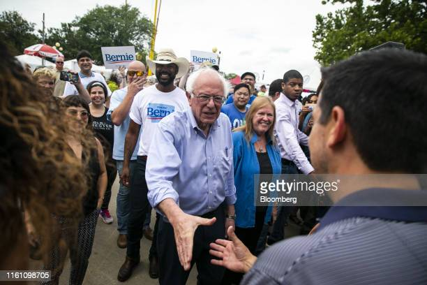 Senator Bernie Sanders an independent from Vermont and 2020 presidential candidate center left and his wife Jane Sanders center right greet attendees...
