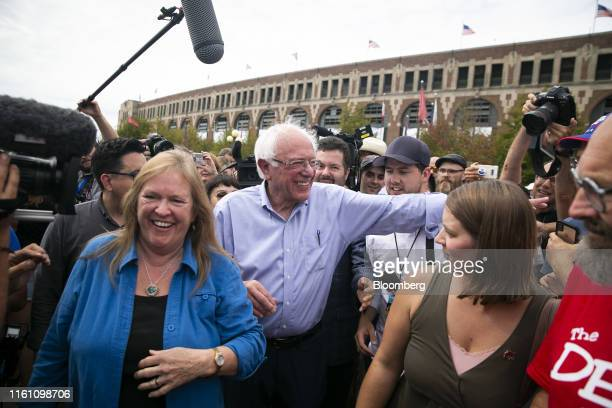 Senator Bernie Sanders an independent from Vermont and 2020 presidential candidate center and his wife Jane Sanders left greet attendees during the...