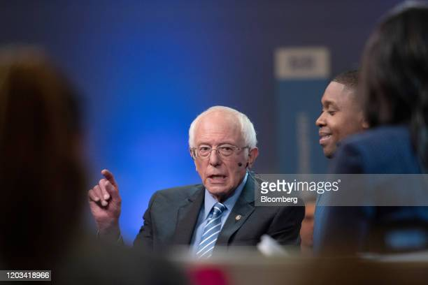 Senator Bernie Sanders an Independent from Vermont and 2020 presidential candidate center speaks to a member of the media following the Democratic...