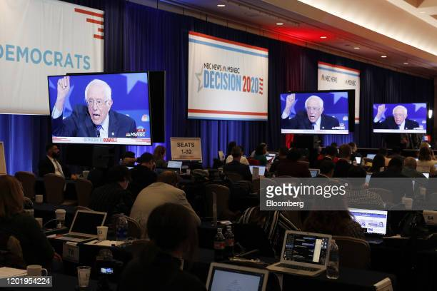 Senator Bernie Sanders an Independent from Vermont and 2020 presidential candidate is seen on television screens in the spin room during the...
