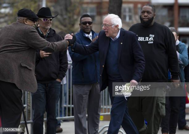 Senator Bernie Sanders an Independent from Vermont and 2020 presidential candidate shakes hands with an attendee while arriving to speak during a Get...