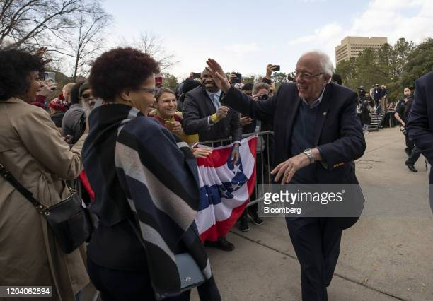 Senator Bernie Sanders an Independent from Vermont and 2020 presidential candidate waves at supporters during a Get Out The Vote Rally at Finlay Park...