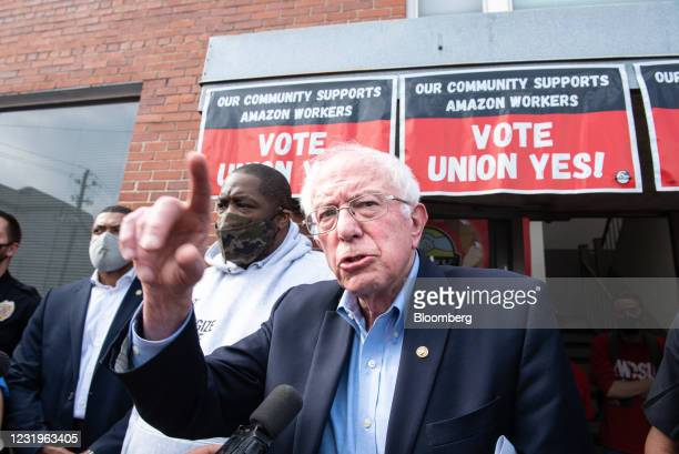 Senator Bernie Sanders, an independent from Vermont, center, speaks outside the Retail, Wholesale and Department Store Union headquarters in...