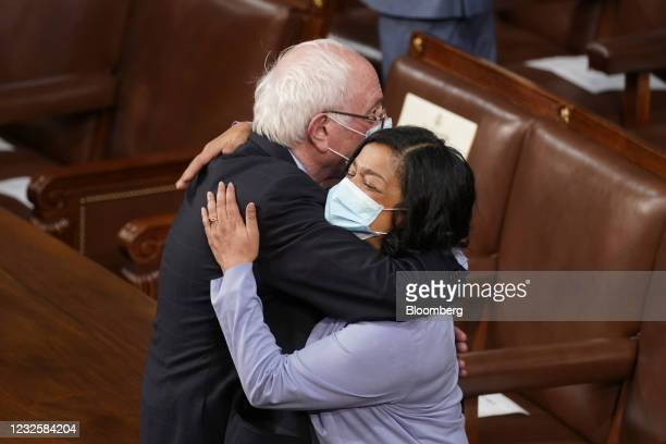 Senator Bernie Sanders, an Independent from Vermont, left, greets an attendee while arriving to speak during a joint session of Congress at the U.S....