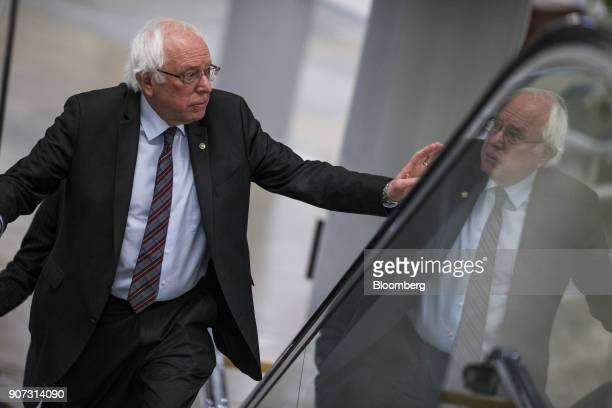 Senator Bernie Sanders an Independent from Vermont rides an escalator in the basement of the US Capitol in Washington DC US on Friday Jan 19 2018 The...