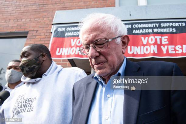 Senator Bernie Sanders, an independent from Vermont, right, and Rapper Micheal Render, known as Killer Mike, outside the Retail, Wholesale and...