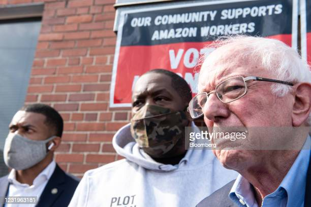 Senator Bernie Sanders, an independent from Vermont, right, and Rapper Micheal Render, known as Killer Mike, center, outside the Retail, Wholesale...