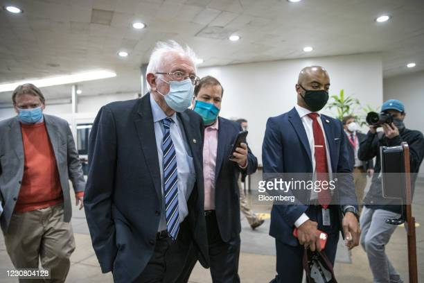 Senator Bernie Sanders, an Independent from Vermont, speaks to members of the media while walking through the Senate Subway at the U.S. Capitol in...