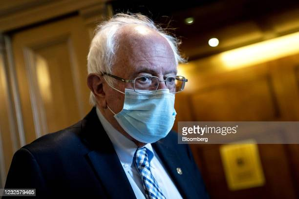Senator Bernie Sanders, an Independent from Vermont, speaks to members of the media while departing the Senate Chamber at the U.S. Capitol in...