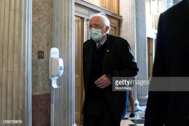Senator Bernie Sanders, an Independent from Vermont, wears a protective mask while walking to the Senate Chamber at the U.S. Capitol in Washington,...