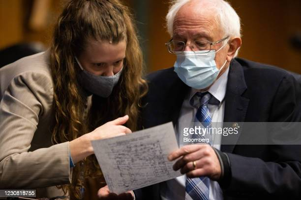 Senator Bernie Sanders, an independent from Vermont, wears a protective mask while talking to a staff member during a Senate Energy & Natural...