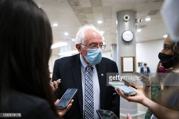 Senator Bernie Sanders, an Independent from Vermont, wears a protective mask as he speaks with members of the media while arriving for a vote in the...