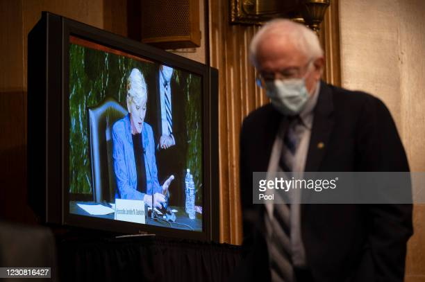 Senator Bernie Sanders, D-VT, paces the hearing room as a hearing to examine the nomination of Former Michigan Governor Jennifer Granholm to be...