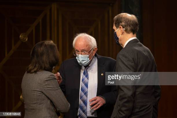 Senator Bernie Sanders , D-VT, speaks with US Senator Maria Canrtwell , D-WA, and US Senator Ron Wyden , D-OR, ahead of a hearing to examine the...