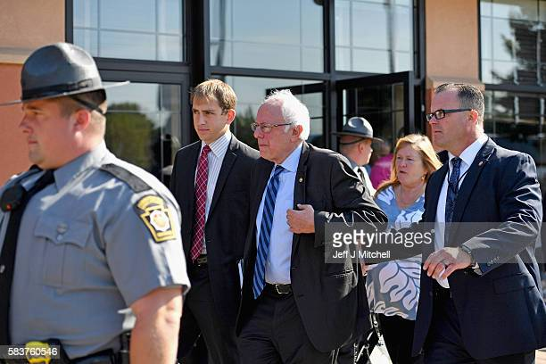 Senator Bernie Sanders exits after addressing the New Hampshire Maine and Vermont delegation breakfast at the Democratic National Convention on July...