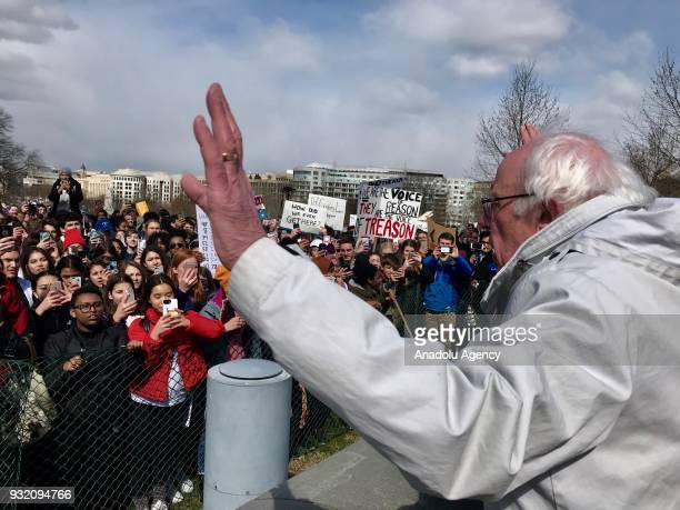 Senator Bernie Sanders greets demonstrators while attending a rally on the West Front of the Capitol to call on Congress to act on gun violence...