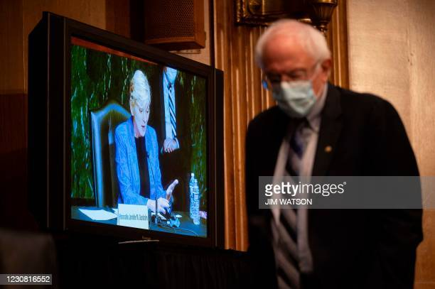 Senator Bernie Sanders, I-VT, paces the hearing room as a hearing to examine the nomination of Former Michigan Governor Jennifer Granholm to be...
